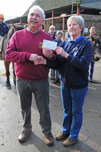 Presentation of cheque by Lion President Geoff Long to Anna Kerr