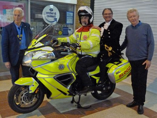 Blood-runner motorbike presented by Lion President Chris Muschamp, Jonathan Lucas, High Sheriff, West Sussex and Alan Shaw of Harbeth Audio