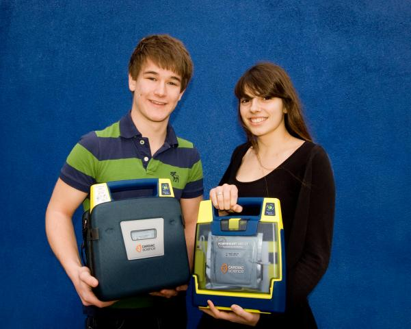 St Paul\'s Head Boy and Girl with Defibrillators for St Paul\'s Catholic College and Downlands School